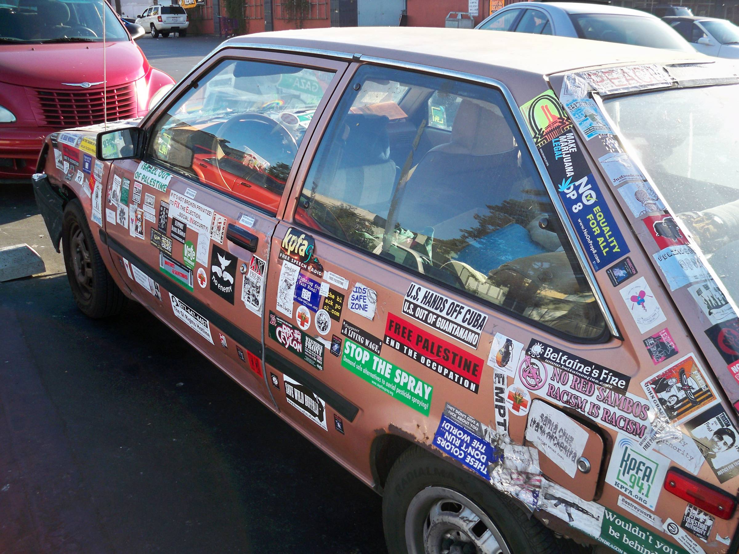 Wow this is a serious bumper sticker lover found in berkeley california where it belongs click to embiggen the entire car was covered in stickers