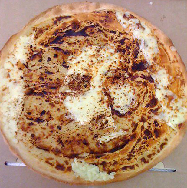 cheese pizza jesus. in a three cheese pizza.